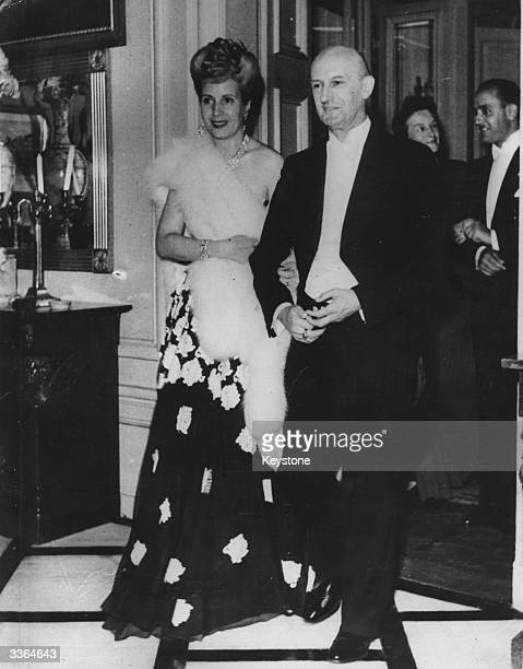 Eva Peron wife of Argentine president Juan Peron being escorted by Dr Philipp Etter president of the Federal Council during a reception at his house...