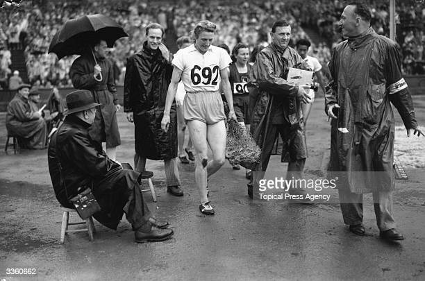 Dutch athlete Fanny BlankersKoen leaving the track at Wembley Stadium after winning the gold medal in the 200 metres event at the Olympic Games in...
