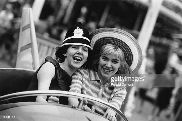 Two dancers from the Bolshoi Ballet Company enjoying a ride at Battersea funfair.