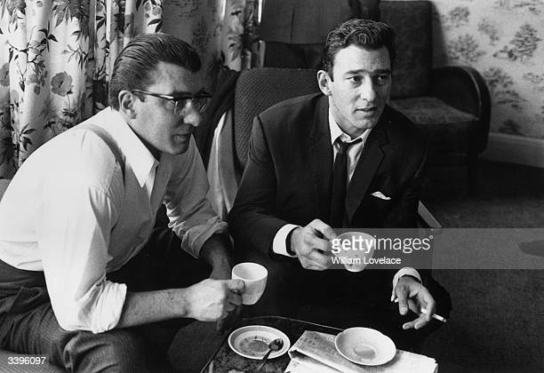 London gangsters Ronnie and Reggie Kray having a cup of tea at home They had just spent 36 hours being questioned by the police about the murder of...