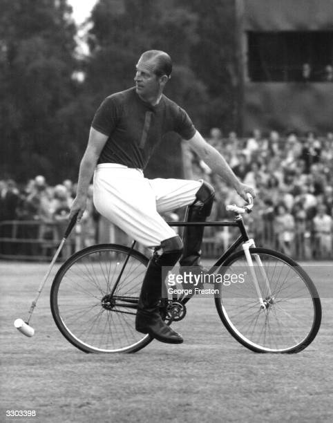 Prince Philip Duke of Edinburgh competing in a bicycle polo match at Windsor Berkshire