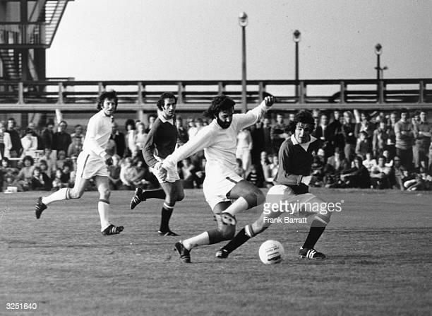 Irish footballer George Best in action during one of the many comebacks of his career this time playing for Dunstable against Manchester United's...