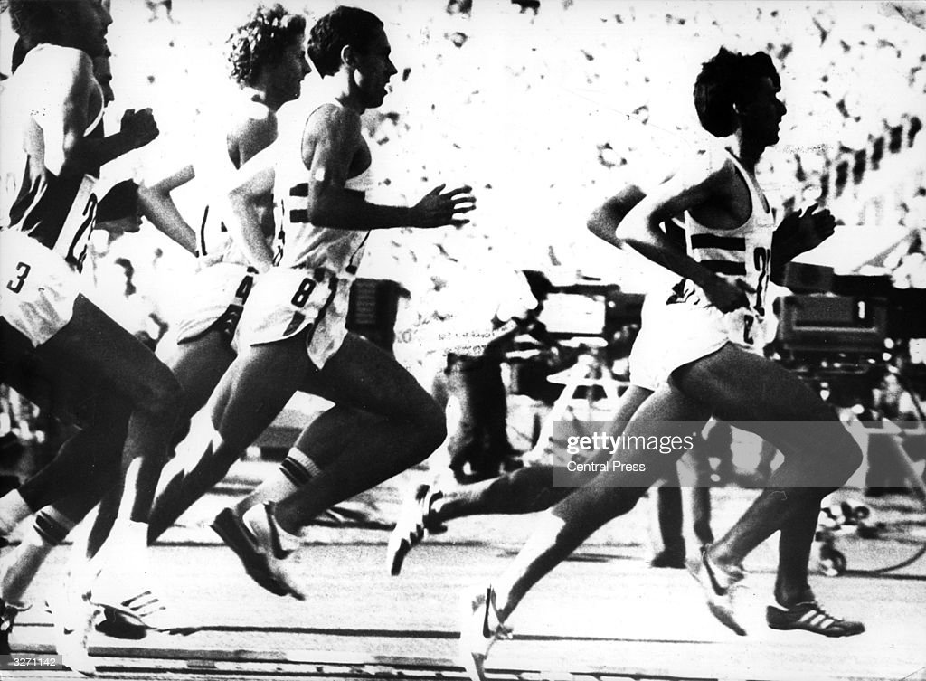 English athlete Sebastian Coe, (right), in front of compatriot Steve Ovett, (centre), during the 1500 metres at the Olympic Games at Moscow, which Coe went on to win.