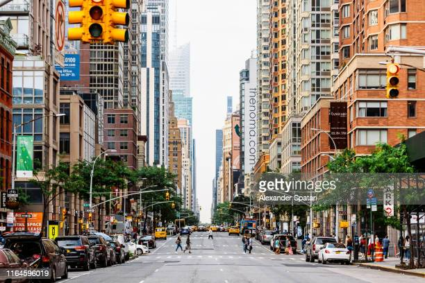 6th avenue in manhattan, new york city, usa - ニューヨーク市 ストックフォトと画像