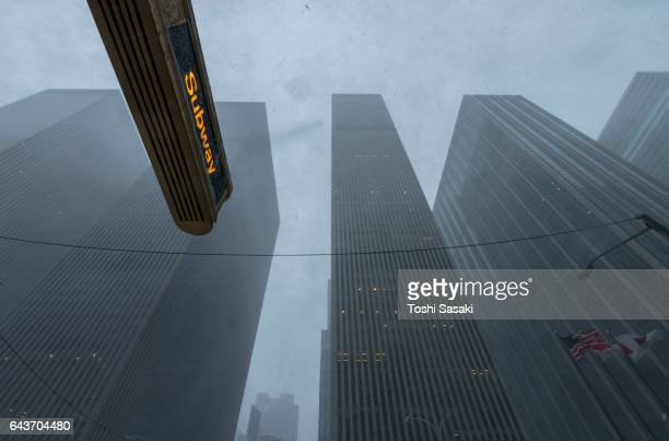 6th avenue skyscrapers in the snowstorm at midtown manhattan new york on 2016. - sixth avenue stock pictures, royalty-free photos & images