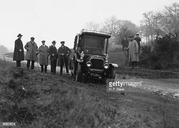 A car being used in a police reconstruction of events surrounding the disappearance of detective story writer Agatha Christie near Newland's Corner...