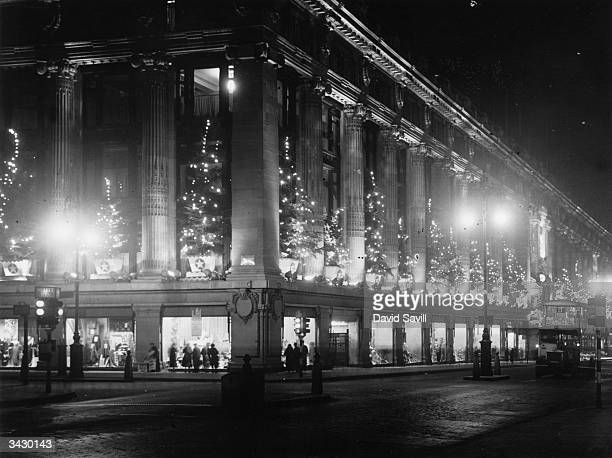 Selfridges Department Store Oxford Street London lit up by christmas decorations