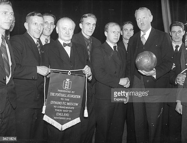 The Football Association presenting a commenorative pennant to Dynamo Moscow at the farewell party held for the football team after their successful...