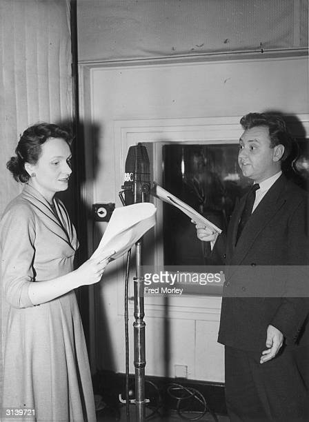 Actors Ysanne Churchman and Norman Painting recording an episode of the radio series 'The Archers' in which they play the engaged couple Grace...