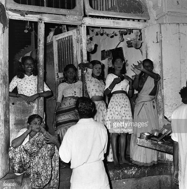 Indian prostitutes stand in a doorway