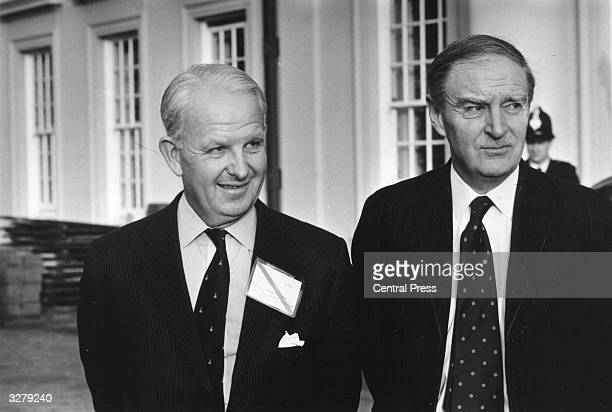 Brian Faulkner the Unionist leader of Northern Ireland with Liam Cosgrave the Prime Minister of Eire in the garden of the Civil Service College at...