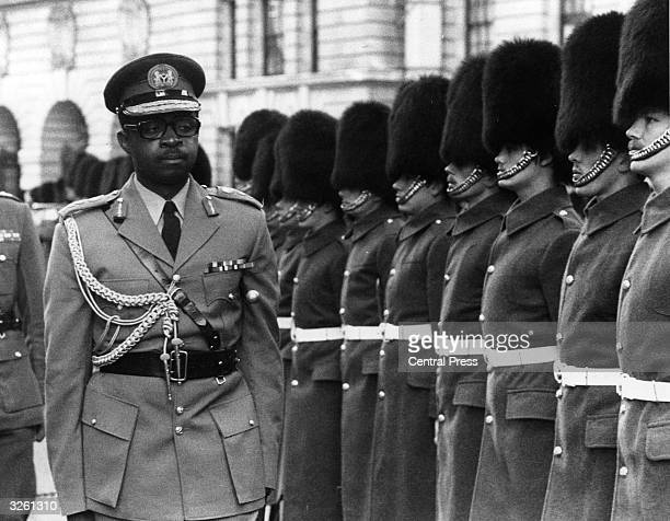 Nigerian Army Chief Lieutenant-General T Y Danjuma inspects the Guard of Honour, 1st battalion Coldstream Guards, at the British Ministry of Defence.
