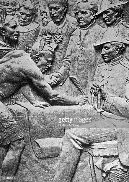 A lowrelief sculpture of Governor William Hobson and the Maori chiefs signing the Treaty of Waitangi in New Zealand