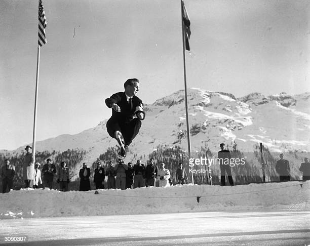 American figure skater Dick Button makes a sensational leap to win the gold medal in the Men's Singles Figure Skating Championships during the...