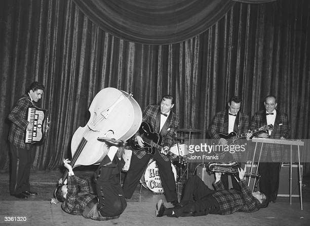 American rock n' roll sensation Bill Haley and his Comets, rehearsing at London's Dominion Theatre.
