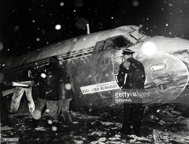 Rescue workers pictured in a snowstorm at the wreckage of the BEA Elizabethan airliner GALZU 'Lord Burghley' after the crash at Munich in which 23...