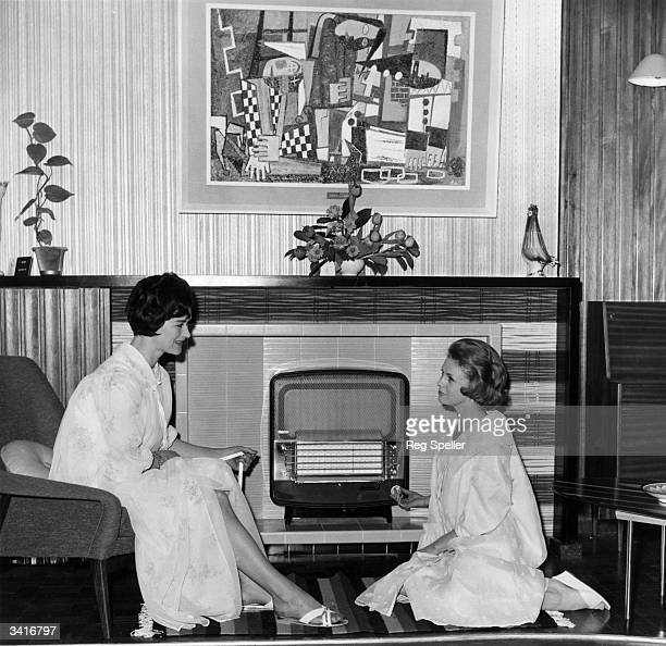 From left to right Susan Hook of Hampstead and Ann Grierson of St John's Wood with one of the latest gas heaters at an exhibition at the Royal...