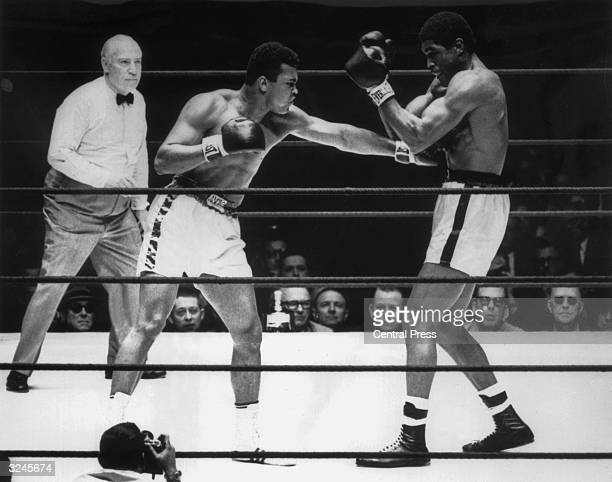 Muhammad Ali delivers a crashing left to Ernie Terrellfs body during their 15round contest in the Astrodome Houston Texas The fight was convincingly...