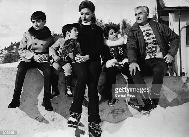 Mohammad Reza Pahlavi the Shah of Persia on holiday in St Moritz with his family Prince Reza Prince Ali Reza Empress Farah Diba Princess Farahnaz and...