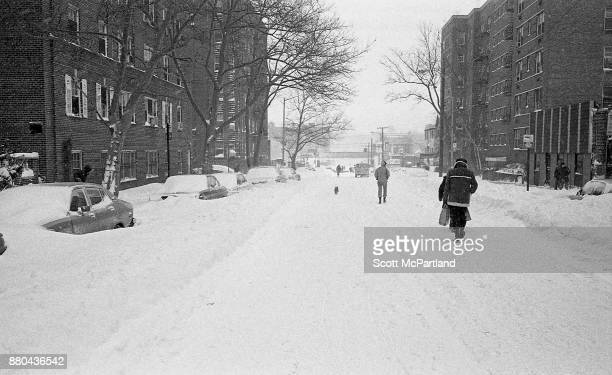 Pedestrians take to walking in the middle of the street in Queens NY during the height of the Blizzard of 1978