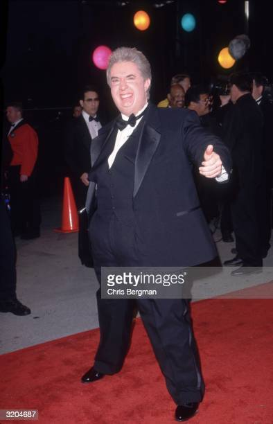 Full-length image of American actor and comedian Martin Short wearing a grossly obese disguise at the American Comedy Awards, Shrine Exposition...