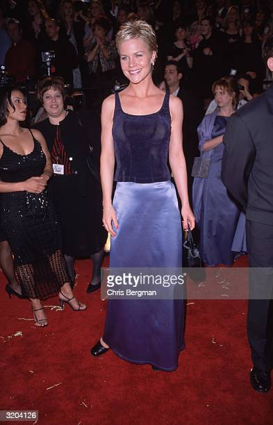 Full-length image of American actor Josie Davis smiling while standing on the red carpet at the American Comedy Awards, Shrine Exposition Center, Los...