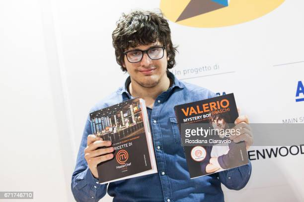 6th Italian Masterchef Valerio Braschi poses with Masterchef Italia 2017 books at Tempo Di Libri Book Show on April 22 2017 in Milan Italy