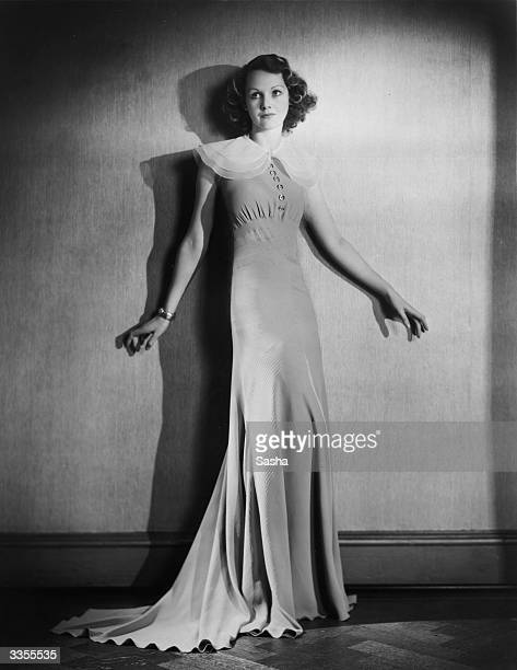 British film actress Elizabeth Allan wearing a long dress