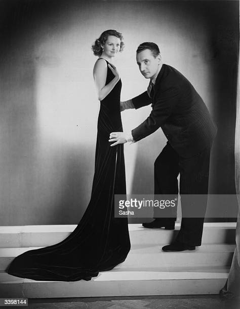 Elizabeth Allan the English film star who is to work for MGM films in Hollywood being fitted in a very slinky black velvet dress