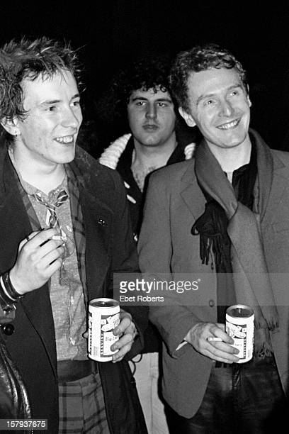 6th JANUARY: John Lydon and manager Malcolm McLaren of the Sex Pistols holding cans of Budweiser beer at the Taliesyn Ballroom in Memphis Tennessee...
