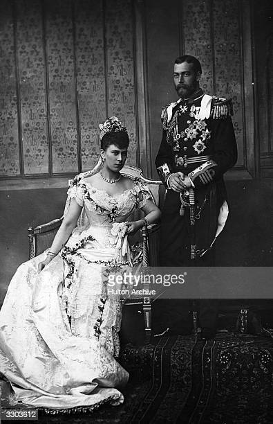 King George V on his wedding day with his bride Princess Mary of Teck seated
