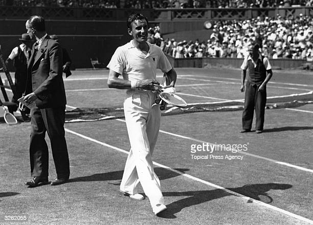 A jubilant Fred Perry of Great Britain walks from the Centre Court at Wimbledon after winning the first of three successive Men's Singles titles...