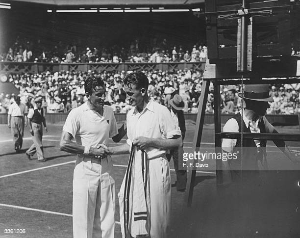 British tennis player Fred Perry being congratulated by Jack Crawford of Australia after his victory in the men's singles final at Wimbledon London