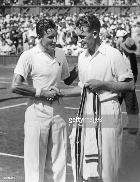 British tennis player Fred Perry being congratulated by Jack Crawford of Australia after Perry's victory in the men's singles final at the Wimbledon...
