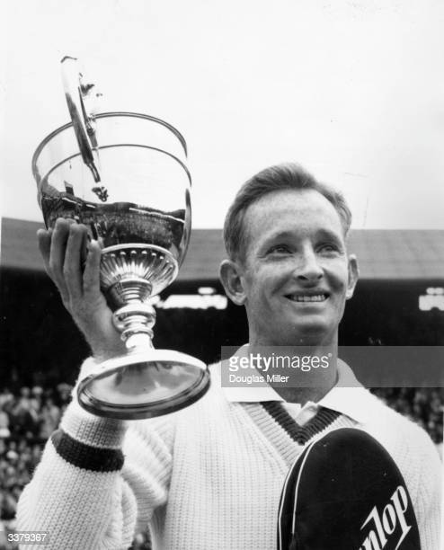 Australian tennis player Rod Laver with the trophy after beating Marty Mulligan to win his second men's singles title at the Wimbledon Lawn Tennis...