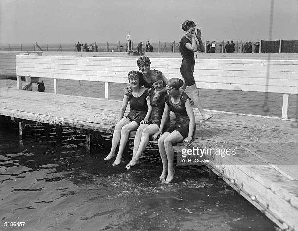 Women bathers at the lido Southport, Lancashire, dip their feet in the water.