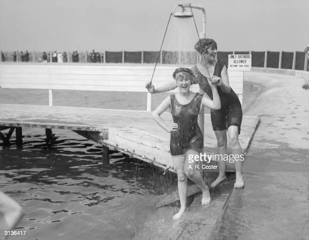 Women bathers at the lido Southport Lancashire take a shower