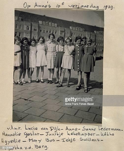 Group portrait at Anne Frank's 10th Birthday party taken from her photo album, Merwedeplein, Amsterdam, Holland.