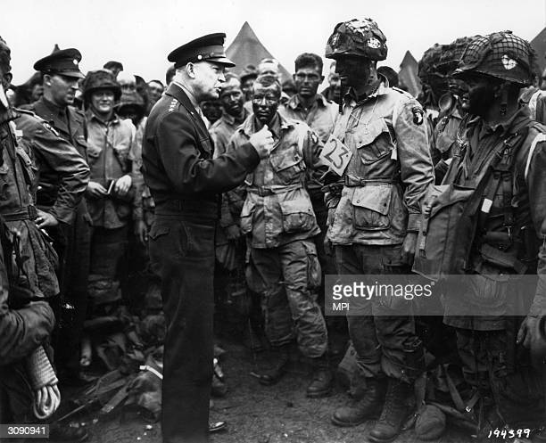 Allied commander in chief General Dwight D Eisenhower talks to paratroopers of the 101st Airborne Division about to take off for the DDay landings in...