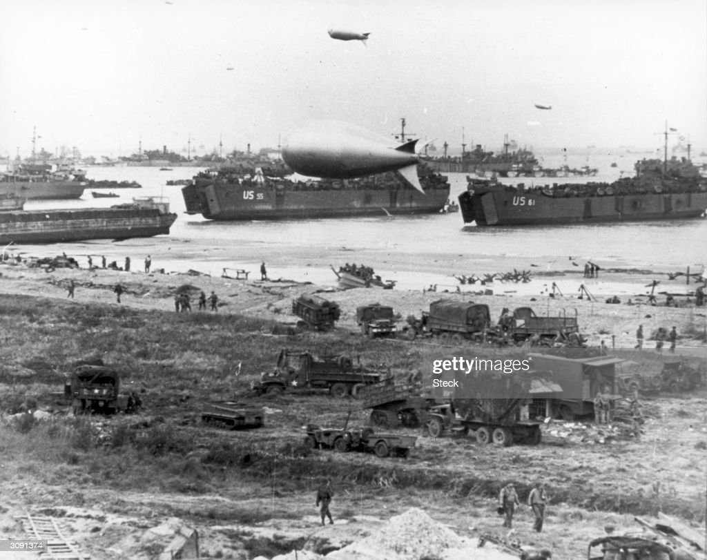 Allied soldiers, tanks and ships take part in the D-Day