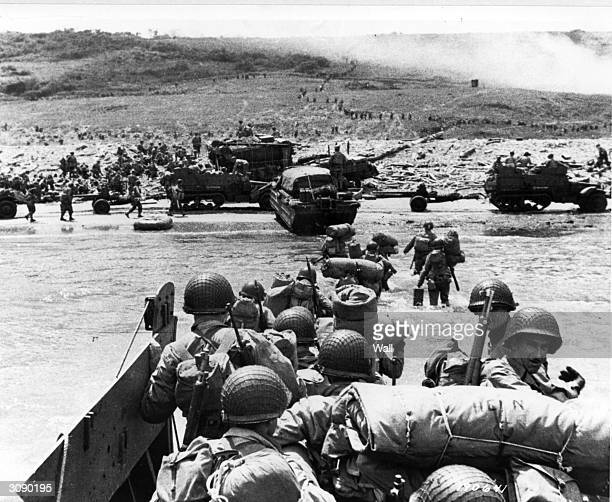 American assault troops land at Omaha Beach in Normandy supported by Naval gunfire