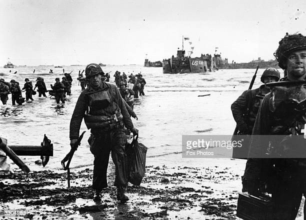 American assault troops wading ashore on Omaha beachhead in Normandy.