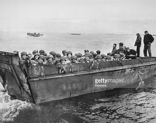 American soldiers on a landing craft on their way to the Normandy beaches during the invasion of Europe