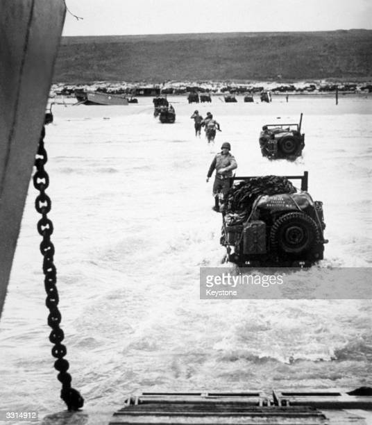 One of the first pictures of the DDay landings in Normandy showing US jeeps and men landing on the French coast