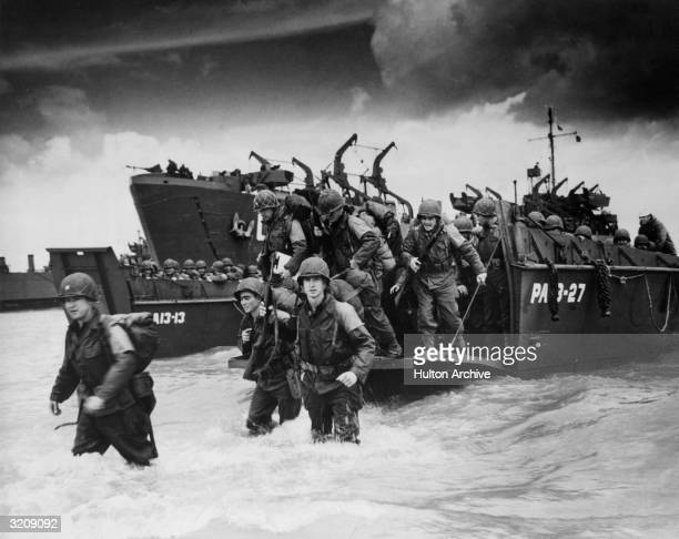 Reinforcements disembarking from a landing barge at Normandy during the Allied Invasion of France on DDay
