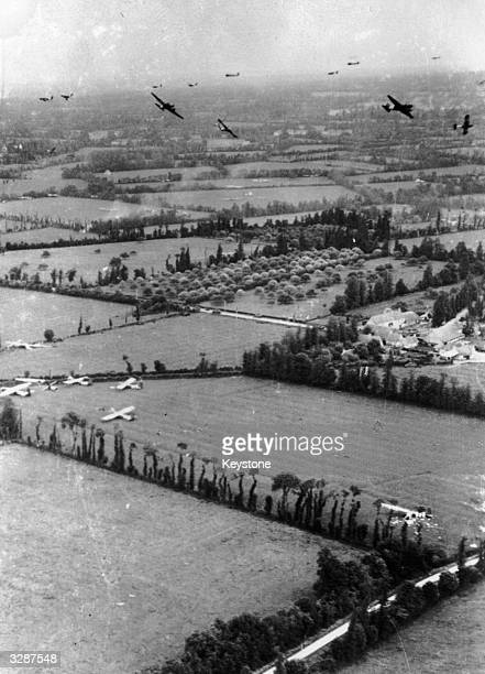 Taken on DDay the fields of Northern France are covered with Waco gliders of the Ninth Airforce Troop Carrier Command whilst other gliders prepare to...