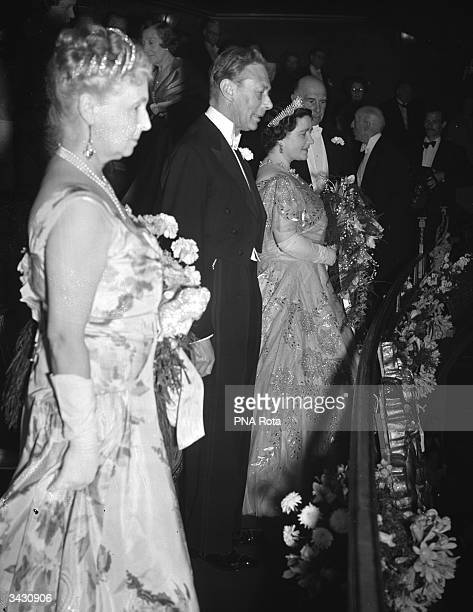 Queen Elizabeth and King George in the Royal Box at the first showing of the British film 'Odette' at the Plaza Cinema Regent Street London