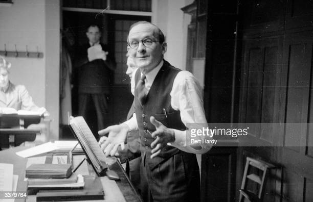 Dr William McKie the Australian born organist of Westminster Abbey rehearses the Abbey choirboys for the forthcoming coronation service of Queen...