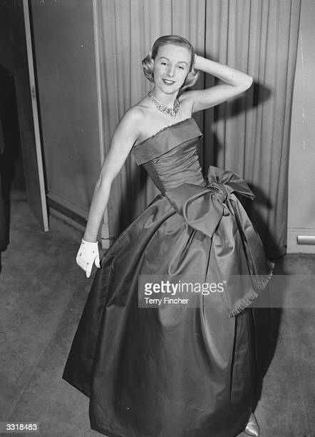 Greta Grimshaw modelling 'Grandbal' a rose red silk organza ball gown with petal overskirt on a slim ankle skirt at the London showing of Christian...