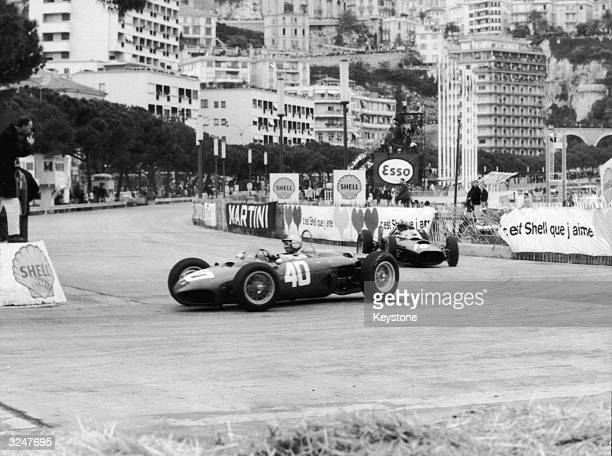Belgian racing driver Willy Mairesse leads Graham Hill of Britain during the Senior Grand Prix at Monte Carlo.